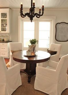 wood dining table + white slipcovered chairs