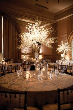 This tall white centerpiece by Trochta's Flowers is a stunning center of attention.  Photography by Shannon Ho Photography. #wedding #centerpiece #white