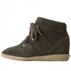 Isabel Marant Bobby Low-Top SneakerLace-up, low-top suede sneaker with hidden wedge heel & pinked trim. Rounded toe with suede cap / Perforated detail & pinked trim throughout / Lace up front with cotton laces & matt silver eyelets / Suede overlay cutouts at ankle / Padded trim around ankle opening / Soft suede tongue / Approx. 3 hidden wedge heel / Leather lining & insole / Treaded translucent rubber sole / 100% Leather / Shoe covers included Color: Beige