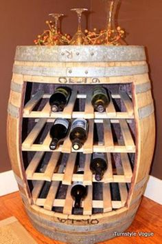 An old barrel turned into a wine rack, what a clever idea, and gives such a nice aesthetic appeal to any room.