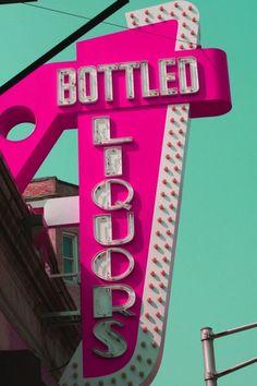 hot pink bottled liquors sign