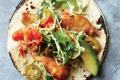 Perfect Fish Tacos- From Bon Appetit. A taco dream come true: crispy, light-as-air fried fish, balanced by a creamy slaw and fiery, cooling, and crunchy fixings. Seafood Recipes, Mexican Food Recipes, Cooking Recipes, Dinner Recipes, Cilantro Recipes, Tilapia Recipes, Avocado Recipes, Party Recipes, Lunch Recipes