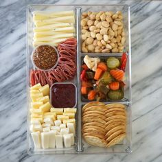 charcuterie board Use a simple drawer organizer to take your cheese boards on the go with this simple trick for making a Trader Joe's cheese board on-the-go. Charcuterie Recipes, Charcuterie And Cheese Board, Cheese Boards, Charcuterie Picnic, Snacks Für Party, Appetizers For Party, Appetizer Recipes, Game Night Snacks, Simple Appetizers