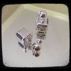 Square Double Face Earrings NEW WITHOUT TAGS. Metallic silver studded double face earrings. Jewelry Earrings