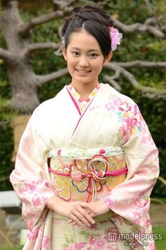 Lovely young lady, loving the kimono, obi and ties