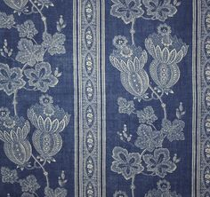 Maud Linen Fabric An elegant floral linen fabric with alternating stripes and floral vines in blue.