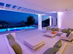 Luxury villa comes with a cozy outdoor lounge (next to a great swimming pool) and various terraces which impress with a fantastic view over the bay of Port Andratx, Mallorca. Enjoy highest luxury and modern living.
