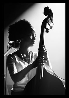 Esperanza Spalding by Yann Renoult. Beautiful picture of her and she has an amazing voice. Love her musical notes...