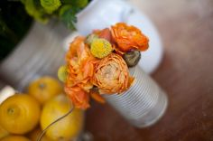 flowers in can would make awesome and EASY centerpeices... great for a barn wedding
