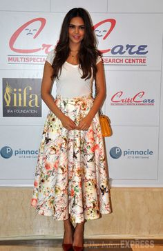 Esha Gupta dressed in a floral skirt at the inauguration of a health centre in Mumbai.