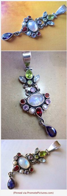 Multi Gemstone Moonstone Sterling Silver Pendant, Articulated, Vintage #pendant #vintage #multigem #sterlingsilver #moonstone #gemstones #articulated https://www.etsy.com/RenaissanceFair/listing/582387219/multi-gemstone-moonstone-sterling-silver?ref=listings_manager_grid  (Pinned using https://PromotePictures.com)