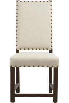Cannot get enough of this upholstered dining chair. Larger brass nailheads line the edges of this chair. It's simple in shape and color scheme, but it is so striking. The clean lines and modern style will pair perfectly with any round, square or rectangle dining table. #12DaysofDeals2016