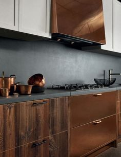 Combining traditional materials in a modern way with a #Wood and #copper #kitchen.