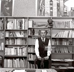 Italian writer and painter Dino Buzzati posing in his studio in his house in Milan. Milan, 1960s.