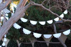 paper doily bunting to decorate railings, behind cake table, bartender, etc.