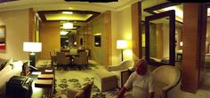 Marina Bay Sands Hotel Singapore   Looking towards dinning and kitchen Trevor relaxing on the 50th floor suite