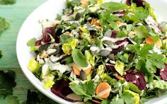 This lovely salad has vibrant greens, creamy agave and miso dressing, beet chips and pumpkin seeds for crunch, and carrot for bite. Yum!