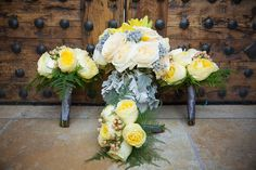 Beautiful bouquets with muted yellow and ivory rose and dusty miller  Venue - Sassi Photographer - Terry McKaig #youreventflorist #arizonaweddings
