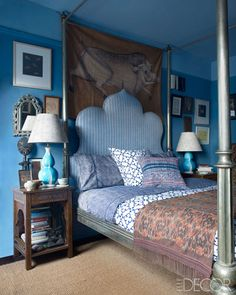 Designer John Robshaw's New York Home The master bedroom's vintage cloth   painting, bed, and bedding are from John Robshaw Textiles, the lamps are by Christopher Spitzmiller, and the walls and ceiling are painted in Benjamin Moore's Kensington Blue and New Hope Gray.