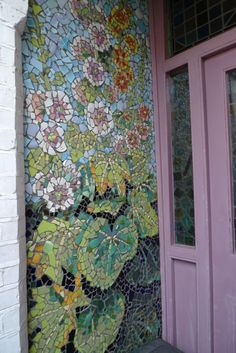 Mosaic by Kaffe's front door. LOVE!