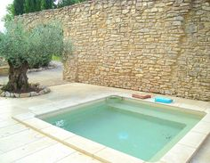 Provence House with plunge pool. Stone wall reminds me of mapostería fences and walls in Mexico.