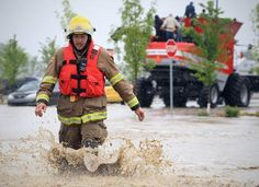 A Nanton fire fighter (brought in to assist) wades through the flood water in High River, Alberta Thursday, June The town of High River was hit by massive flooding Thursday. Photograph by: Tijana Martin, Calgary Herald Bragg Creek, Emergency Responder, Search And Rescue, Fire Dept, Live In The Now, Emergency Preparedness, Slammed, Ottawa, Calgary