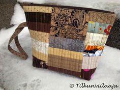 Quilted zipper pouch with a 25-cm zipper, by Tilkunviilaaja -- Kissankielet-vetoketjupussukka Street-mallistoa