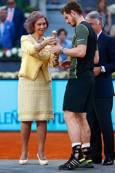 Andy Murray of Great Britain receives the winners trophy from Queen Sofia of Spain after his win over Rafael Nadal of Spain in the final during day nine of the Mutua Madrid Open tennis tournament at the Caja Magica on May 10, 2015 in Madrid, Spain.