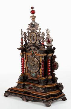 A GERMAN EBONY, EBONIZED WOOD, WALNUT, SILVER, GLASS AND HARDSTONEMOUNTED CASE CLOCK. Maker unknown, Germany, 17th century .