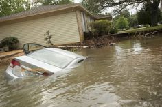 April 28-May 6, 2014 storms, tornadoes, flooding in Florida.  A submerged car sits in the driveway in the Cordova Park neighborhood in Pensacola, Florida.