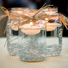 Love the mason jar centerpiece idea. Maybe with some colored beads at the bottom with out wedding colors?