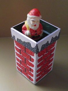 Vintage Christmas Santa Claus Collectible ~ Tin Wind-Up Toy ~ When wound up, Santa goes up and down in the tin chimney. Circa, 1950's.