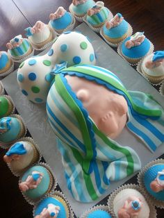 - New little prince themed pregnant belly baby shower cake. I was sent napkins and a plate photo to match the cake to the theme. They wanted a pregnant belly cake with the two feet. I had some trouble with the one foot on this cake and almost cried because it almost tore the fondant (no a thin spot there)  :-( It was a hard one to make the stripes for. Hope it is still enjoyable :-) Thanks for looking.    ~ How fun - I love it❗️