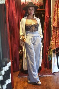 "Fatima Robinson « ""When I'm walking in Paris [wearing this] all the men stare-- they're trying to look and see if they can see nipple. That's the best thing about this... then they realize they can't see it, and they keep going. But it's funny. I was picking up my son one day, and he was like, 'Mom! You're naked, Mom!' I love it."" Fendi pants and shoes, vintage bustier from Rose Bowl Flea Market, vintage shawl from Scout Vintage, Fabio Quaranta hat, earrings from Sardinia, Hermes bracelets"