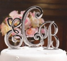 Luxury Monogram Wedding Cake Toppers...how funny, the right letters just out of order.. but super cute