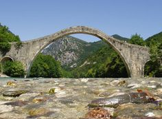 Plaka Bridge is a stone one-arch bridge located at the borders of Arta and Ioannina prefectures, above the waters of Arachthos River, Places Around The World, Around The Worlds, Arch Bridge, Over The River, Urban Planning, Heaven On Earth, Crete, Athens
