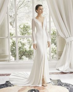Rosa Clara 2019 Couture Wedding Dresses Simplicity, elegance and sensuality combine in this sheath wedding dress. It combines a silk crepe skirt featuring a wide [. Greek Wedding Dresses, Slit Wedding Dress, Making A Wedding Dress, Sheath Wedding Gown, Stunning Wedding Dresses, Wedding Dresses Photos, Backless Wedding, Bridal Dresses, Beautiful Dresses
