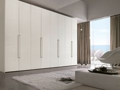 The Tomasella Liscia Armoire Composition 101 features a Hinged door wardrobe with Matt Chalk White 221open-pore lacquered PLAIN door and handle. The Liscia Armoire has Chalk White 221 open-pore lacquered end side panels as well. This beautiful Armoire is very useful for storange and organization and is a perfect addition to any contemporary bedroom.