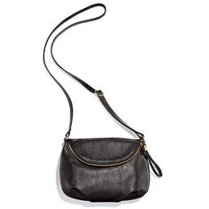 """Look like a million! Fully-lined black, leatherlike crossbody with goldtone hardware, snap closure, top flap zipper pocket as well as one zip and two inner slip pockets. Overall size is11 1/2"""" H x 16"""" W x 5 1/2"""" D. Features an adjustable strap (maximum length, 27 1/2"""" L) and a handle drop of 9"""".  · PVC/plastic  · ImportedIn the event of unforeseen demand, please allow 4-6 extra weeks for delivery."""