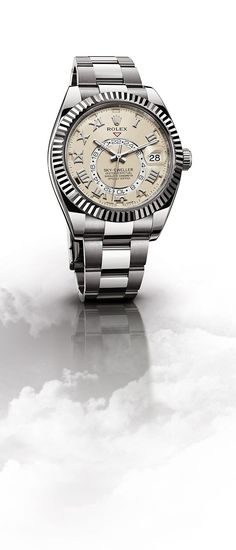 The distinctive ivory dial with Roman numeral appliques of the Rolex Sky-Dweller…