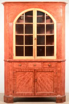 "Sold $2,100  York County, Pennsylvania Grain Paint Decorated Softwood Two-Part Corner Cupboard attributed to John Rupp, (1809-1899) Hanover, Pa. Bold grain painted decoration, stepped cornice with two arched glazed doors and reeded stiles, above three split dovetailed drawers, two lower double paneled doors, sunken and molded stiles, molded base with block feet. 93""h. x 64""w. x 28""d. Condition: good with normal wear."