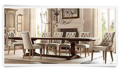 Restoration Hardware. White chairs, massive table, chandelier.