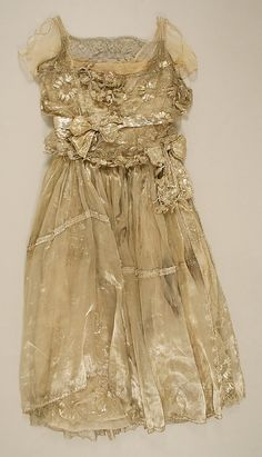 Dress, Evening  Lucile (British, 1863–1935)  Date: 1910s Culture: British Medium: metallic thread Dimensions: Length at CB: 45 1/2 in. (115.6 cm) Credit Line: Purchase, New School for Social Research Fund, 1993 Accession Number: 1995.294 [many photos]