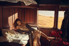 """Amy Adams reading for Allure, July 2013. Photograph by Norman Jean Roy. Adams arrived at the Allure shoot from Boston on a train—and promptly posed in another one reading a book. """"Sequined wool coat and satin-and-lace dress by Louis Vuitton. Python shoes by Marc Jacobs. Wool tweed bag by Chanel."""""""