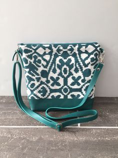 A personal favorite from my Etsy shop https://www.etsy.com/listing/497368638/teal-crossbody-bag-leather-crossbody-bag