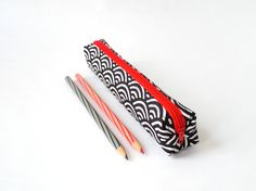 Small pencil case/zipper pouch in black and white Japanese waves, with a contrasting red zip and lining