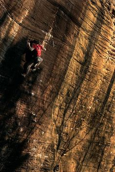 Rock climber climbing Black Gold in the Red River Gorge, Kentucky