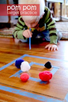 Pom pom target practice for preschoolers -- by blowing!