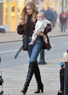 Turning heads: The 29-year-old cut a stylish figure in tight denim jeans and a chic brown ...