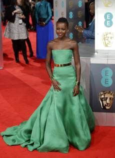 Kenyan actress Lupita Nyong'o arrives on the red carpet in Christian Dior Couture for the 2014 EE British Academy Film Awards ceremony at The Royal Opera House in London, Britain, 16 February 2014. The ceremony is hosted by the British Academy of Film and Television Arts (BAFTA). EPA/FACUNDO ARRIZABALAGA